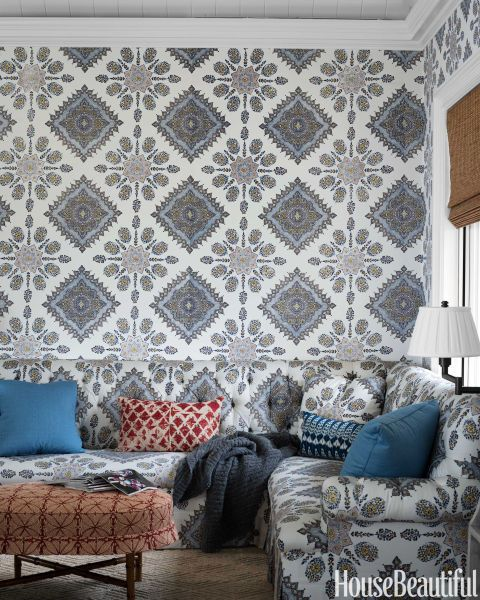 """In the adjoining family room of a Greenwich, Connecticut, house, designer Lee Ann Thornton covered the walls and sectional in the same fabric, Quadrille's Persepolis: """"I wanted the space to feel more hip and fun,"""" she says. The ottoman is covered in Martyn Lawrence Bullard's Kabba Kabba. Inca carpet, Patterson Flynn Martin."""