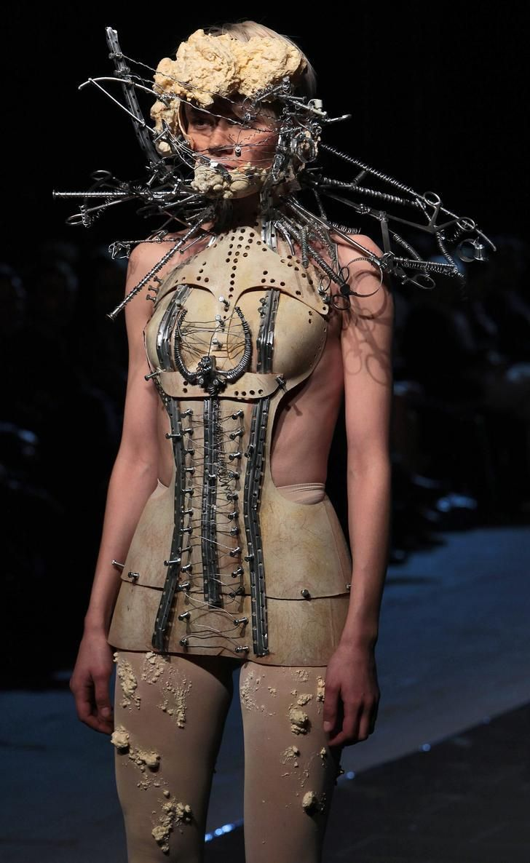 "Katarzyna Konieczka- Designer and Stylist. S)  Im all over any kind of aged ""brace"" look.   She looks like a dentistry automaton."