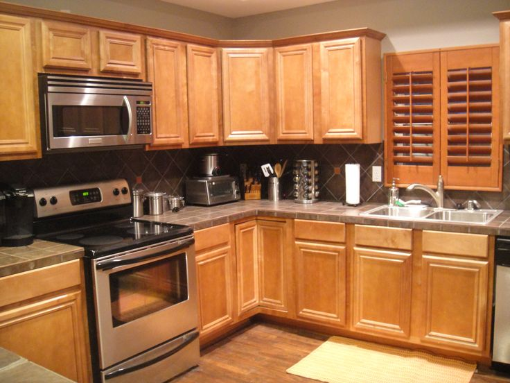 Countertop Dishwasher Pakistan : honey oak cabinets with very dark grey wall, light grey counters and ...