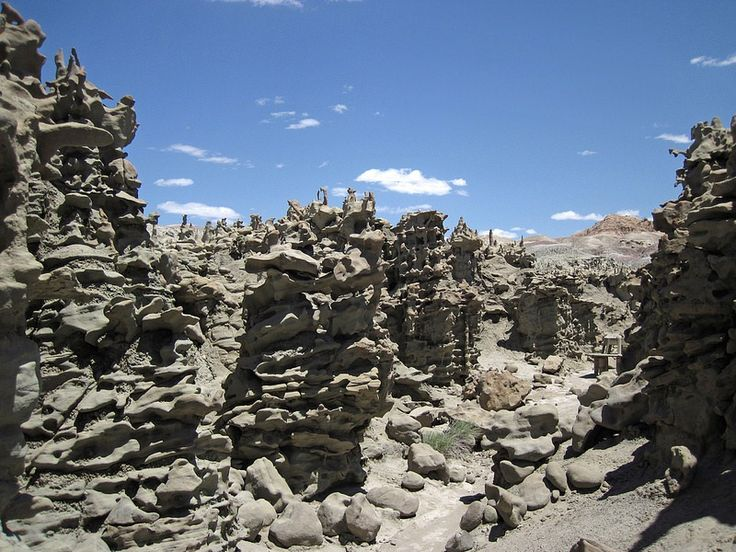 """Fantasy Canyon is located about 25 miles south of Vernal, in northeastern Utah, United States. This small area, which is not really a canyon, is packed with some of the most uniquely weathered rock formations bearing colorful descriptive names such as """"Flying Witch"""", """"Screaming Man"""" and """"Alien Head""""..."""