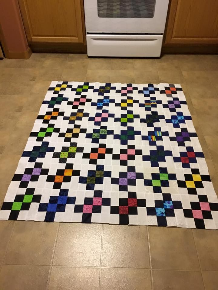 Garlic Knot, pattern by Bonnie Hunter.  Quilt by Catherine Walczak-Postal.  Love the black and white with the bright colors.