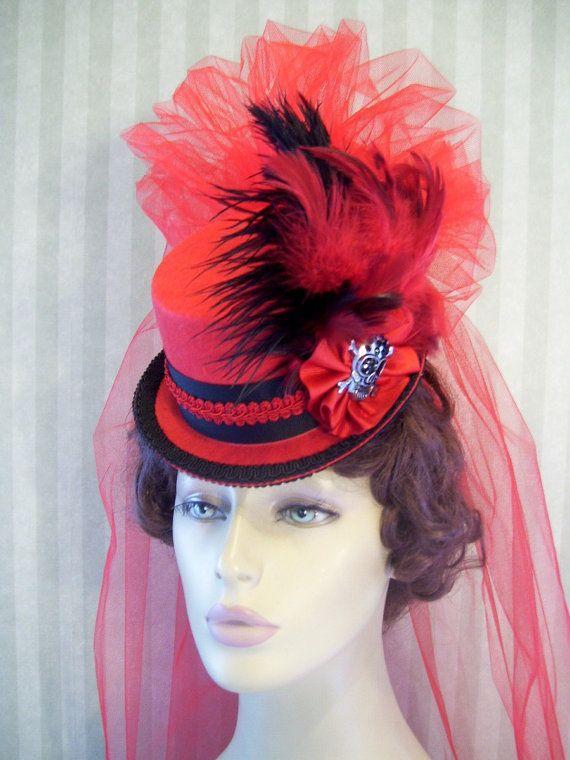 Mini Top Hat Steampunk Hat Halloween Hat Derby Hat Lolita Hat Neo Victorian Hat Skull and cross bones. $36.99, via Etsy.
