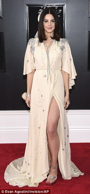 Lana Del Rey oozes glamour in plunging gown with star halo | Daily Mail Online