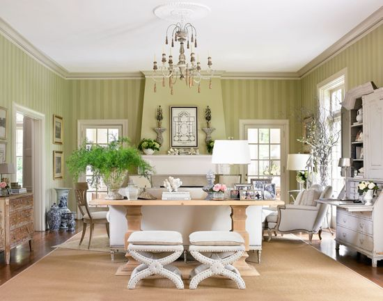 Warm greens and neutrals give this living room a fresh and inviting feel  - Traditional Home®  Photo:Emily Followill Design: Lillian August