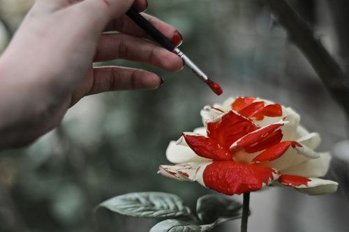 The girl who paints nature to change its colors - a fairy queen? Slave to the nature queen?