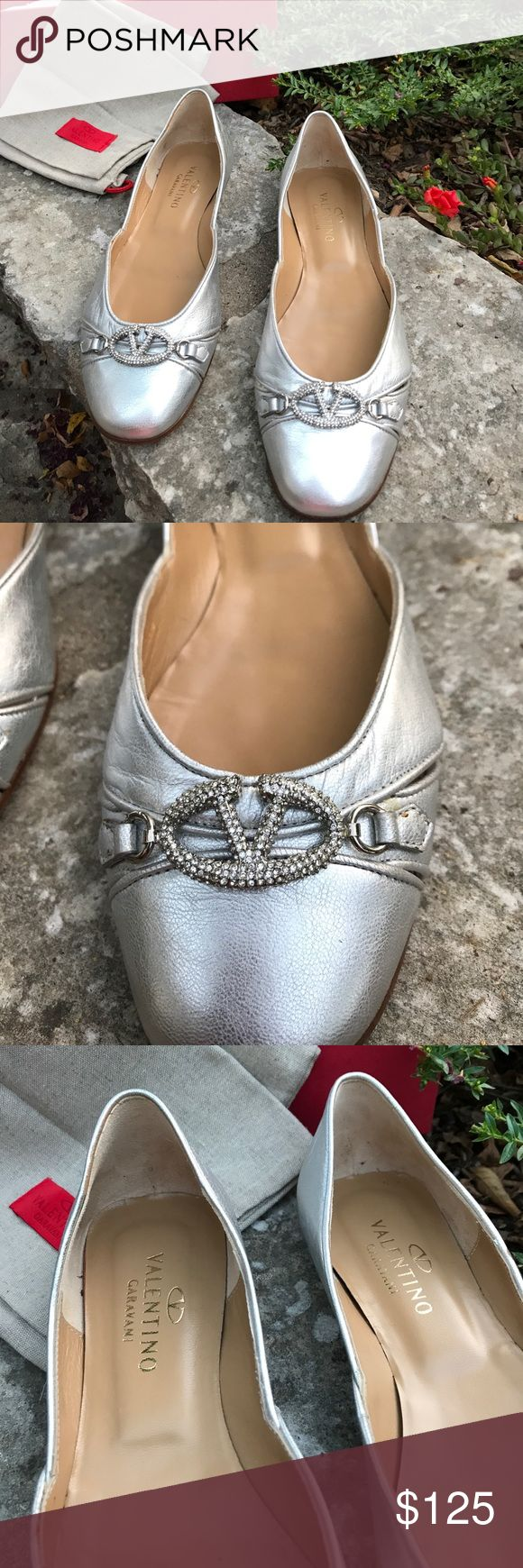 Classic New Valentino silver logo flats Silver crystal logo in the front.Valentino flat size 38.5. Please are new in box. I do notice a small nick as shown in photo. This would not be visible when wearing. Valentino Shoes Flats & Loafers