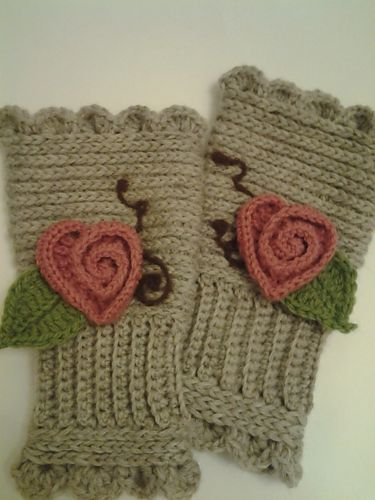 "Don't have much use for ""texting gloves,"" but exploring her blogsite turned up some great techniques--flowers, hearts and braid pattern of crochet (looks like knitting!)"