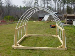 -use PVC to connect support beams for PVC arches instead of wood like in this photo, wood frame for base and PVC connector beams, easier to buy longer pieces of PVC as well for a bigger run