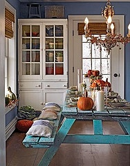 picnic table...turquoise paint...pillows...a dining room... This is really cute.  But I'm afraid if I put a picnic table in my dining room, it would look like....a picnic table in the dining room!