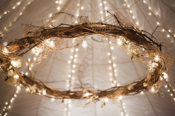 We saw a picture of this hula-hoop chandelier on Pinterest, and my father-in-law made it happen! It was definitely a statement piece at our reception. (Wynona Benson Photography) #rusticwedding #chandelier
