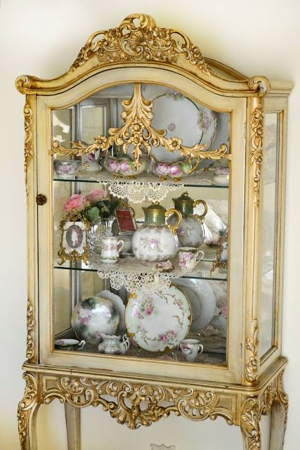 China collection in French curio cabinet