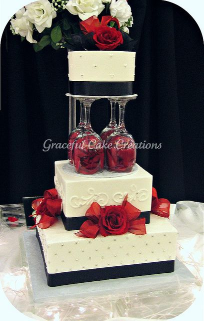 I have Zero use for this pin- it's just pretty & i like to look ay it!!  Elegant White, Black and Red Wedding Cake.I love the way the wine glasses are being used here.