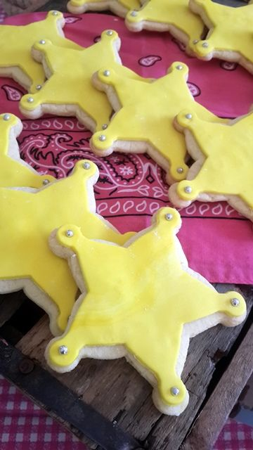 Sheriff badge cookies- Use yellow icing, gold balls on the star tips, and gold luster dust when the icing dries completely