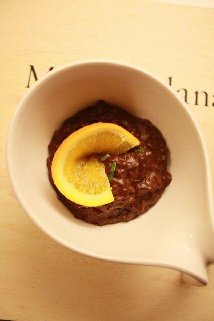 Dark chocolate risotto with orange flesh and rosemary