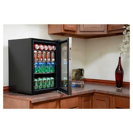 The NewAir AB-850 84 can beverage cooler offers flexible storage, optimal temperature control and a compact design that fits anywhere. This mini-fridge has 7 thermostat settings between 34°F and 64°F and offers 2.2 cubic feet of storage to hold a variety of cans, bottles and snack foods. With its classy black and stainless steel design, this refrigerator is the perfect addition to your home bar.