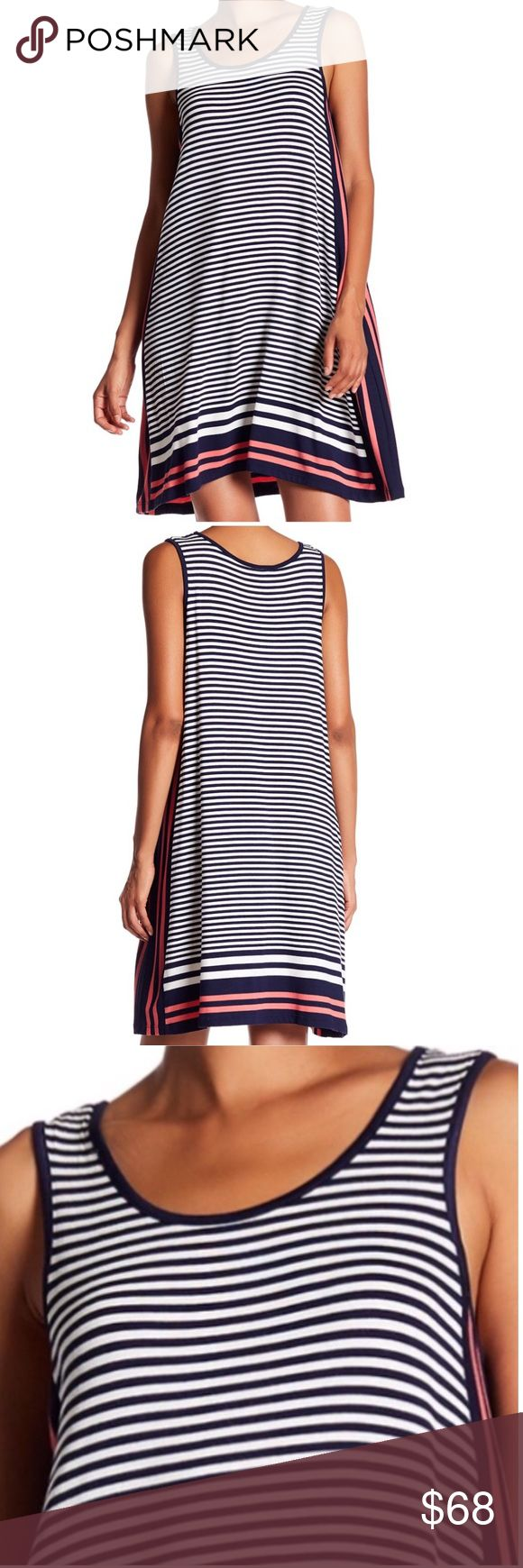 MAX STUDIO Stripe Tank Trapeze Dress size Small MAX STUDIO Stripe Tank Trapeze Dress size Small   BRAND: Max Studio SIZE: Small COLOR: NVCORLTS (Navy & Coral) MATERIAL: 95% rayon, 5% spandex CARE: Machine wash cold. Lay flat to dry  CONDITION: NEW with tags STYLE: 7904F65 RSRP: $98 DETAILS: Stripes Tank dress. Scoop neck. Sleeveless. Slip on style. Made in China.   True to size   APPROXIMATE MEASUREMENTS:  Length: 39 inches Max Studio Dresses Mini