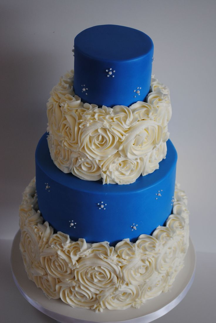 Round Wedding Cakes - Royal Blue and Roses - German Chocolate Cake with Coconut-Pecan Filling and Chocolate Ganache.  Roses are vanilla buttercream (tutorial by Iambaker) and the royal blue is fondant.  This is actually copied from a photo of a cake I was given, I never did find out who designed the original, but I thought it was gorgeous! TFL!