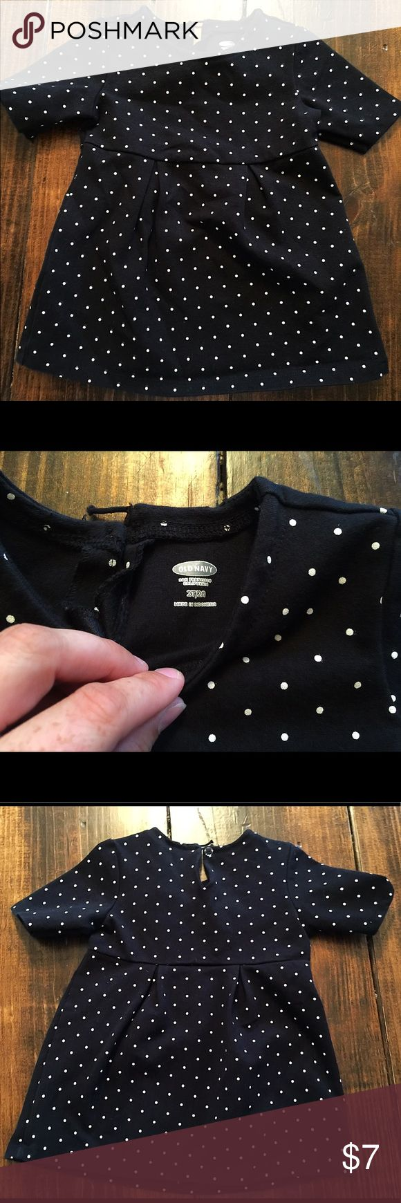 Black short sleeve dress with white polka dots Dress is in great condition. There's a little loop on the back of the dress that has come undone. It could be easily fixed. Old Navy Dresses Casual