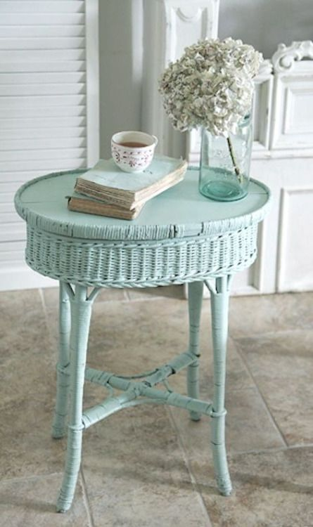 Wicker side table gets new life with a coat of light turquoise paint. shabbyfufu.com