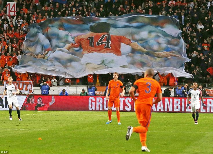 Dutch supporters at the Amsterdam Arena unfurl a banner in tribute to the late Johan Cruyff