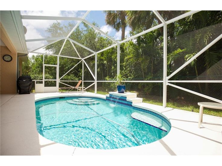 CBS 3/2 split plan with den home in a gated community. Freshly painted exterior, new stainless steel kitchen appliances, natural gas, screened in gas heated pool, gas hot water heater & stove, corian countertops, fenced yard, walk in closets, garden tub in master, tropical landscaping, new well for sprinkler system, most interior rooms freshly painted as well. Move right in this beauty!  $279,000 | The M&M Group 772.202.3594