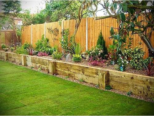raised bed in front of fence