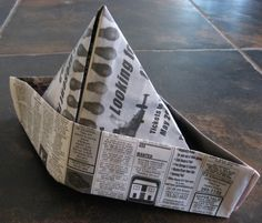 Newspaper Pirate Hats for the Cub Scout Raingutter Regatta. I think I will tape a craft feather on to add some color. #Scouting #Scouts