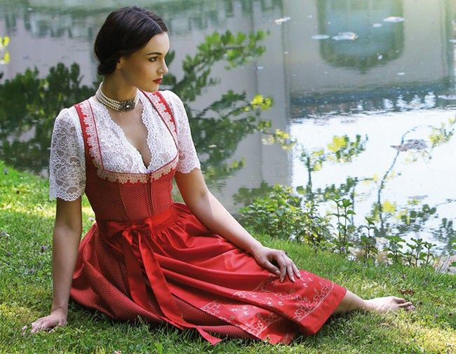 Elegant red dirndl with V-neck lace blouse