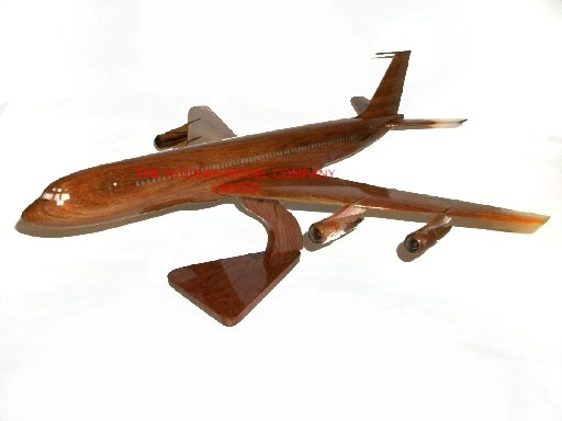 "A beautiful hand carved desktop model of the Boeing 707. The model has been carved from solid mahogany. The model comes boxed and is simple to assemble. The wings, tail fins and stand simply slot into pre-drilled holes on the body of the aircraft. No glue required. Size H 9"", L 20"", W 20"". Visit our website at thewoodenmodelcompany.co.uk to view the full range of our models."