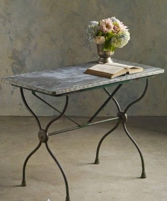 Giverny Garden Table from Soft Surroundings.  We found this charming table at a French brocante. Crafted of cast iron with a zinc top, this century-old antique is just like many of the tables found in bistros, bars and cafés all over France.   Get your rebate from RebateBlast.
