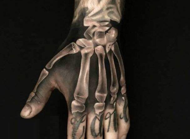 тату на руке кости