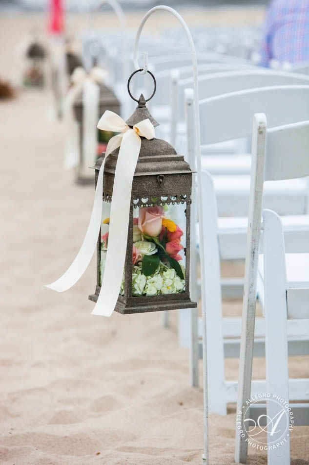 beach wedding aisles-wooden lanterns with flowers lining the aisle