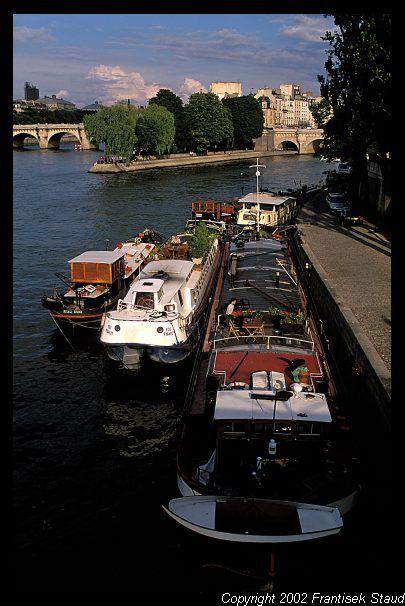 Boats anchored along the Seine river   with Ile de la Cite in the background, Paris