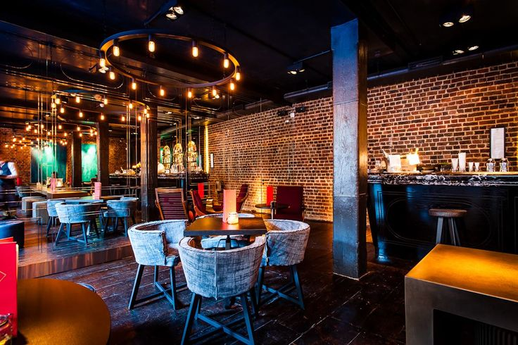 Multi-colour furniture and exposed brickwork: https://hirespace.com/Spaces/London/33095/Old-Bengal-Bar/Whole-Venue/Business