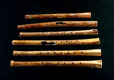 9,0000 year old flutes,the oldest playable musical instrument ever found, were discovered in China.  If you go to the site they have wav files so you can hear someone playing the actual instruments!