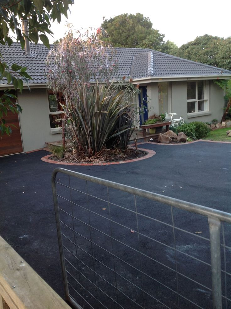 Asphalt driveway. This has made such a difference!