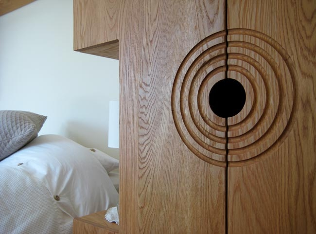 Bedroom furniture in oak with circle motif set into cabinet fronts