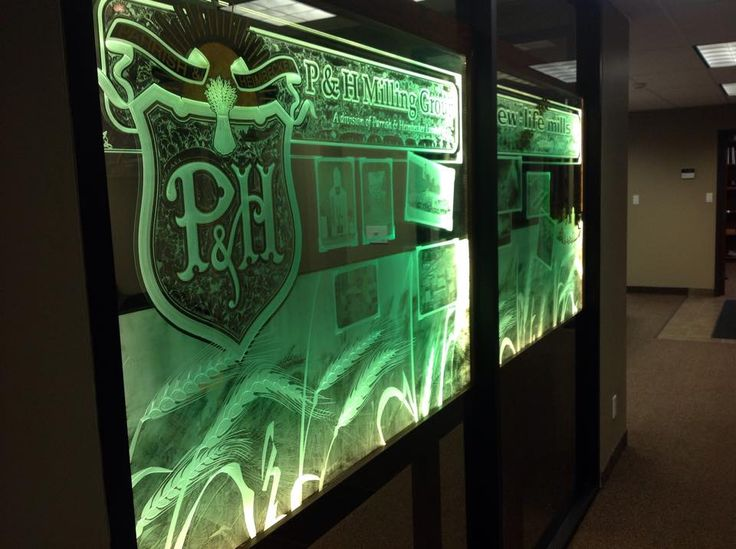 Wildwood Signs Glasswork- boardroom glass partition Sand carved, glue chipped, 24k gold gilding and glass photography 519-364-1503 Canada