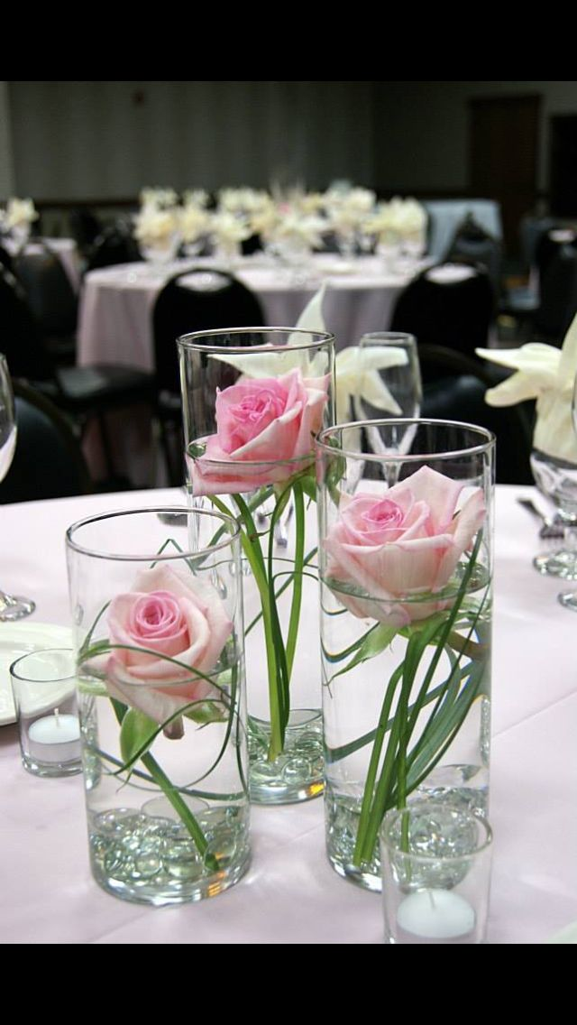 Single flowers in skinny vases centerpiece ideas