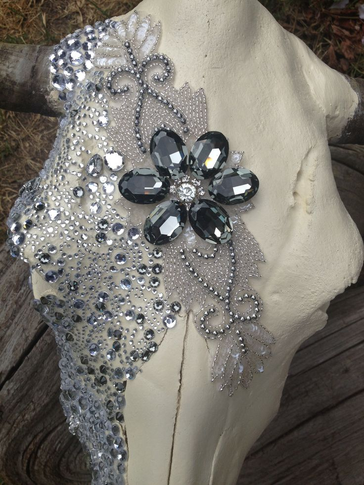 Jack it up designs Swarovski and vintage appliqué cow skull Wouldn't mind doing this to some of my deer skulls