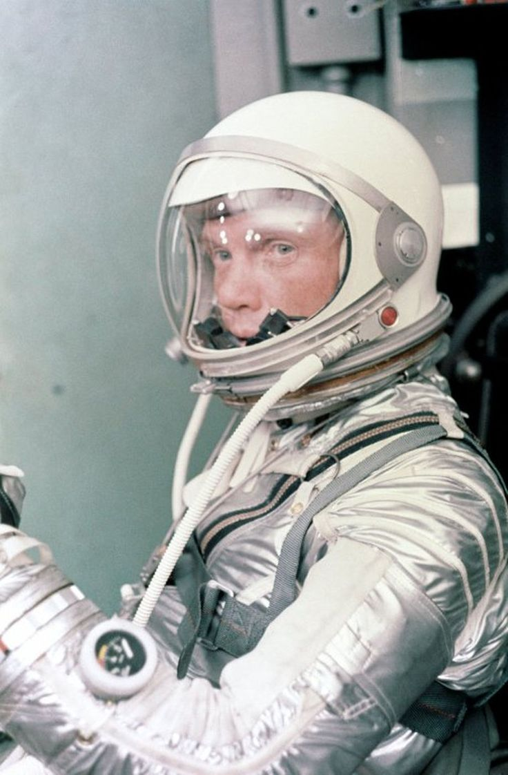 Astronaut John H. Glenn Jr. dons his silver Mercury pressure suit in preparation for launch. On February 20, 1962 Glenn lifted off into space aboard his Mercury Atlas (MA-6) rocket and became the first American to orbit the Earth. After orbiting the Earth 3 times, Friendship 7 landed in the Atlantic Ocean 4 hours, 55 minutes and 23 seconds later, just East of Grand Turk Island in the Bahamas. Glenn and his capsule were recovered by the Navy Destroyer Noa, 21 minutes after splashdown.