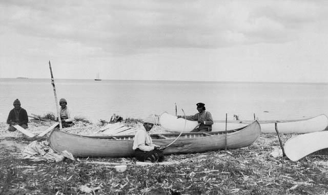 A group of Innu constructing canoes at North West River in Labrador / Des Innus fabriquent des canots à North West River (Labrador)   by BiblioArchives / LibraryArchives