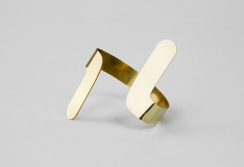 The bracelet, coming together as hyperbole has a simple design language, thus is perfect for an everyday or a more special look.  #jewelry #design #geometry #maths #minimal #contemporary #serajewellery #brass