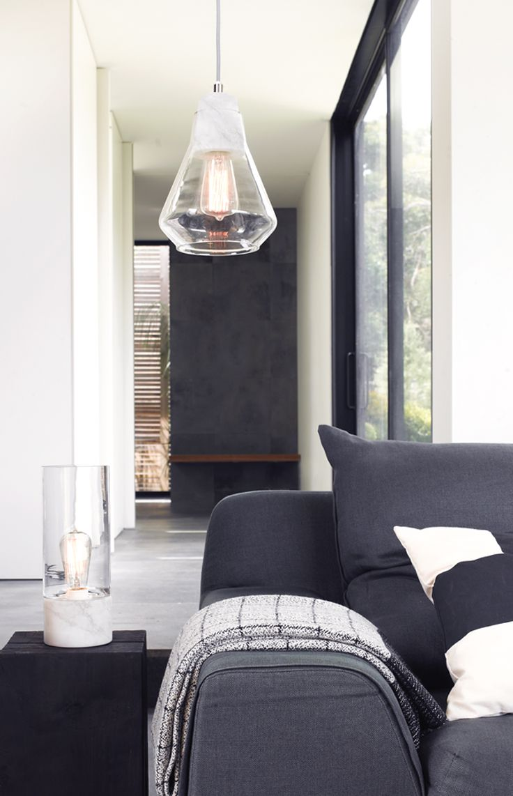 Ando 1 light pendant with marble lampholder, light grey cabling and glass shade.