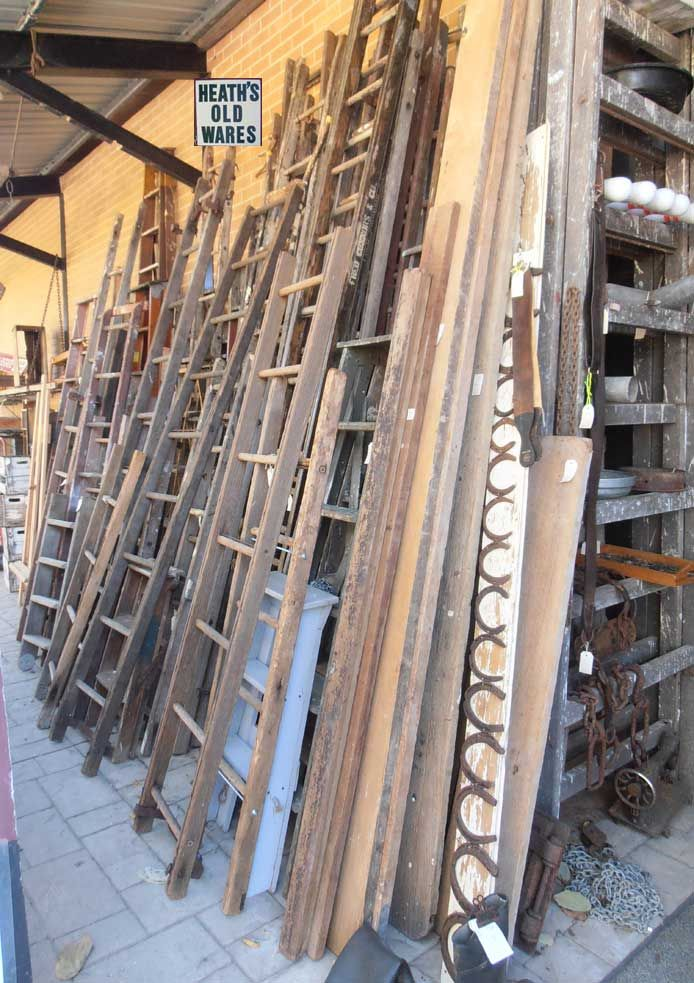 vintage and antique wooden ladders, timber ladders, tools, pliers, sawsets, pincers for sale at Heaths Old Wares and collectables and industrial antiques 12 station street bangalow nsw ph 02 6687 2222