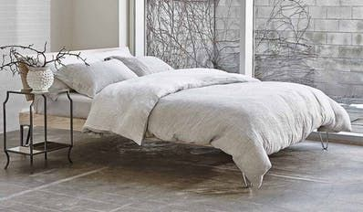 Learn how to set up your bed right, and then win the super luxe bedding set to make it awesome.