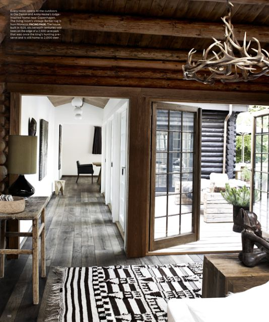 Rustic modern. black+ white + wood ceiling