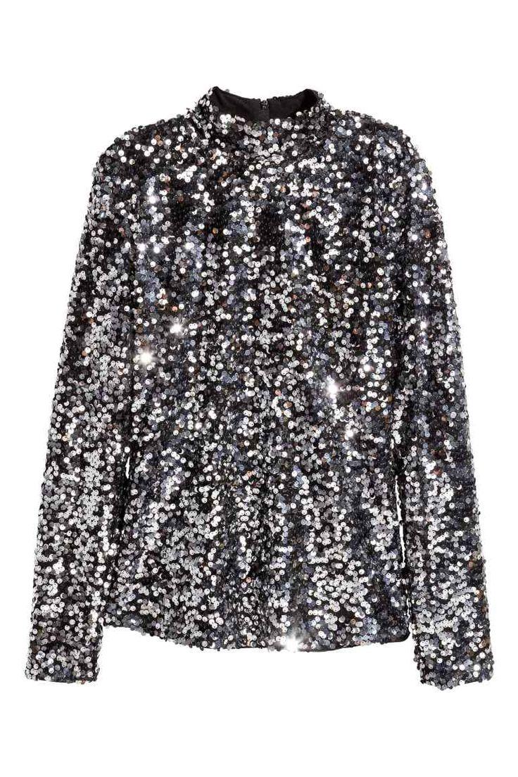 Camisola de lantejoulas: Camisola justa de gola subida em mesh bordada a lantejoulas com camada interior em jersey. Mangas compridas e fecho éclair oculto nas costas.