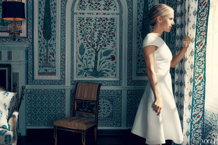Burch, wearing Valentino, in her dining room, with its custom Iznik-inspired panels by Paris design company Iksel.