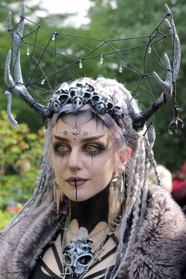 Image 52- A big head piece that would look really good within the hair, the web idea in between horns is also good and something that's worth testing out in between the horns, I also like the eye makeup and how the black fades out.